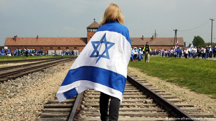A participant draped in the Israeli national flag walks on the railway tracks, during the 'March of the Living' from the former German Nazi death camp Auschwitz I to Auschwitz II - Birkenau, in Brzezinka, Poland, 05 May 2016.