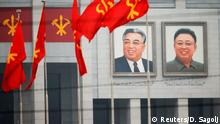 06.05.2016 *** Pictures of former North Korean leaders Kim Il Sung and Kim Jong Il decorate the April 25 House of Culture, the venue of Workers' Party of Korea (WPK) congress in Pyongyang, North Korea May 6, 2016. REUTERS/Damir Sagolj © Reuters/D. Sagolj