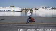06.05.2016+++ A woman carries her luggage in front of docked ferries on strike at the port of Piraeus, near Athens, on Friday, May 6, 2016. Services have ground to a halt in Greece as workers start a three-day general strike protesting new bailout austerity measures they say will further decimate incomes, in a sign of growing discontent with the left-led coalition government. +++ (C) picture-alliance/AP Photo/P. Giannakouris