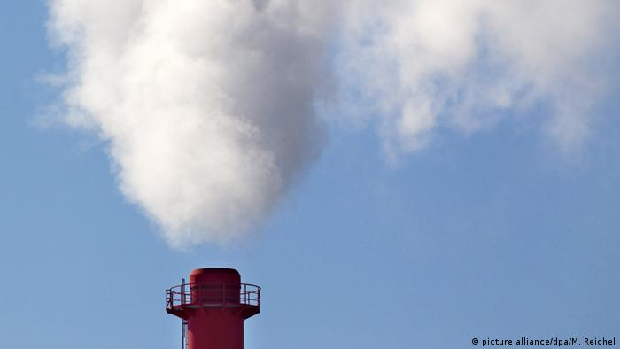 Smoke streaming out of waste incineration smokestack