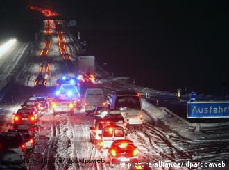 Chaos on Germany's snow-covered highways has claimed the life of two people so far