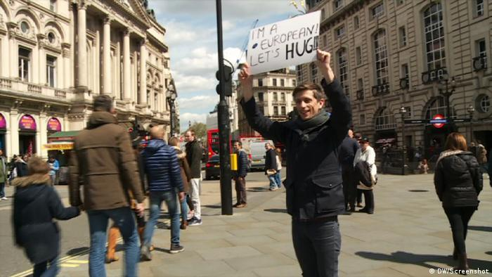 The 'hugabrit' campaign aims to keep the UK in the EU: Here a man stands on a street in London holding a sign above his head that says, 'I'm a European, lets hug'.
