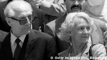 14.1.1993 *** FILES - Picture taken on January 14, 1993 shows former East German President Erich Honecker (L) reunited with his wife Margot Honecker (R) upon his arrival at Santiago Airport in Santiago, Chile. Former East German strongman Erich Honecker religiously knocked back pure lemon juice every morning to ward off colds, his long-serving butler reveals in a new book. The notoriously dour Honecker, who ran communist East Germany from 1976 until just before the Berlin Wall fell in 1989, was very attentive to his health, Lothar Herzog says in 'Honecker Privat' (The Private Honecker). The 190-page memoir is to go on sale a week before the 100th anniversary of Honecker's birthday on August 25. AFP PHOTO / CRIS BOURONCLE (Photo credit should read CRIS BOURONCLE/AFP/GettyImages) Copyright: Getty Images/AFP/C. Bouroncle