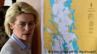 German Defense Minister Von der Leyen examining a map of the Aegean