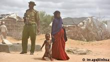 31.7.2015*** (150508) --DADAAB, May 8, 2015 -- A refugee mother and her child walk past an armed police at Dadaab refugee camp in Kenya, May 8, 2015. Dadaab, the world s largest refugee camp in northeastern Kenya, currently houses some 350,000 people. For more than 20 years, it has been home to generations of Somalis who have fled their homeland wracked by conflicts. ) KENYA-DADAAB-SOMALI REFUGEE CAMP SunxRuibo PUBLICATIONxNOTxINxCHN 150508 Dadaab May 8 2015 a Refugee Mother and her Child Walk Past to Armed Police AT Dadaab Refugee Camp in Kenya May 8 2015 Dadaab The World S Largest Refugee Camp in Northeastern Kenya currently Houses Some 350 000 Celebrities for More than 20 Years IT has been Home to Generations of Somalis Who have fled their Homeland wracked by conflicts Kenya Dadaab Somali Refugee Camp PUBLICATIONxNOTxINxCHN imago/Xinhua