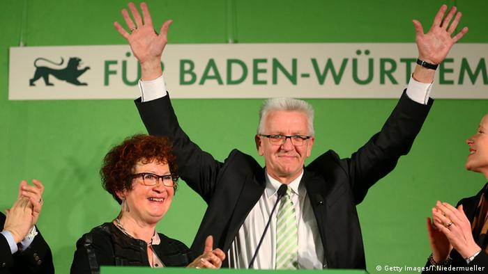 Winfried Kretschmann of the Greens celebrating their victory (Getty Images/T.Niedermueller)
