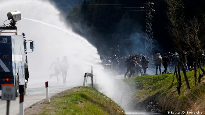 Water cannon being used on protesters