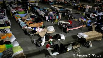 Evacuees shelter in temporary accomodation
