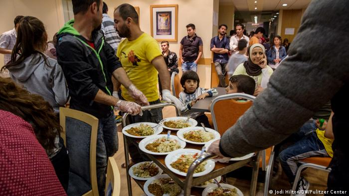 Guests serve dinner in the hotel's dining room