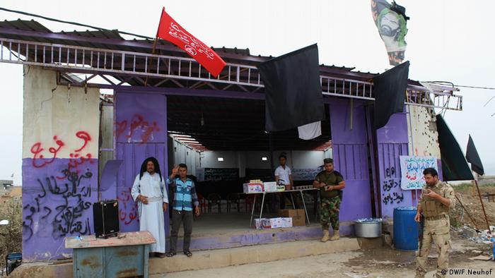 A makeshift community center serving food and drink to the local Shiite militias that retook Bashir from IS