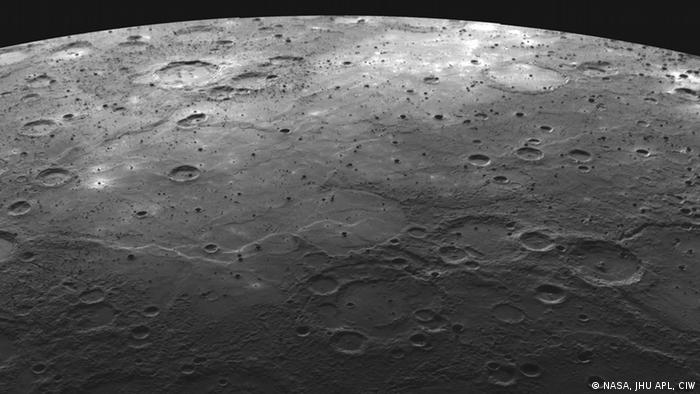 Black and white photograph showing large craters on Mercury