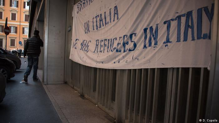 An Eritrean enters an occupied office building on Via Curtatone in central Rome