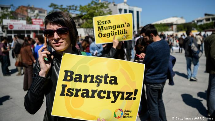 protester holding up sign in Istanbul