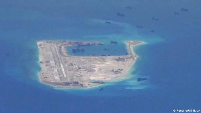 Dredging vessels in the disputed Spratly Islands in the South China Sea