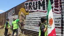Deported Mexicans graffitied a section of the border fence in protest against Donald Trump earlier in May