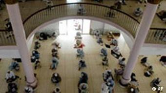 Students offer prayers at the Jamia Binoria madrassa in Karachi
