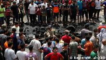 11.05.2016+++ People gather at the scene of a car bomb attack in Baghdad's mainly Shi'ite district of Sadr City, Iraq, May 11, 2016. +++ (C) Reuters/W. al-Okili