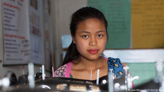 girl behind sewing machine copyright: Jane Mingay/Girls Not Brides