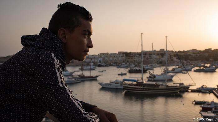 Dihaa Hamami looks down on the port at Lampedusa