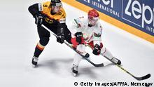+++++++++++ 13.05.2016 +++++++++++++++ Germany's forward Jerome Flaake (L) vies with Belarus' defender Kirill Gotovets during the group B preliminary round game Germany vs Belarus at the 2016 IIHF Ice Hockey World Championship in Saint Petersburg on May 13, 2016. / AFP / ALEXANDER NEMENOV (Photo credit should read ALEXANDER NEMENOV/AFP/Getty Images) (c) Getty Images/AFP/A. Nemenov