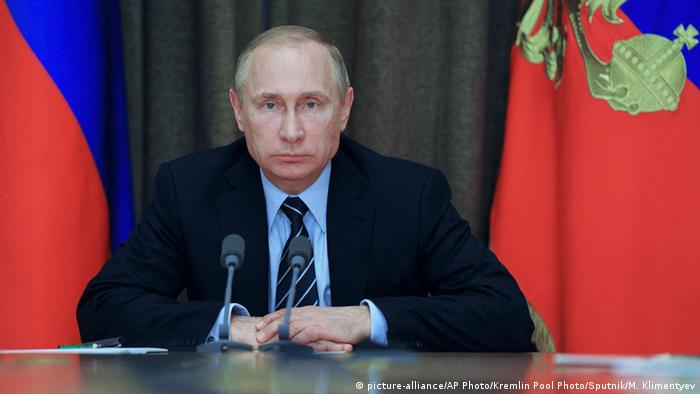 Russian President Vladimir Putin chairs a meeting with military officials