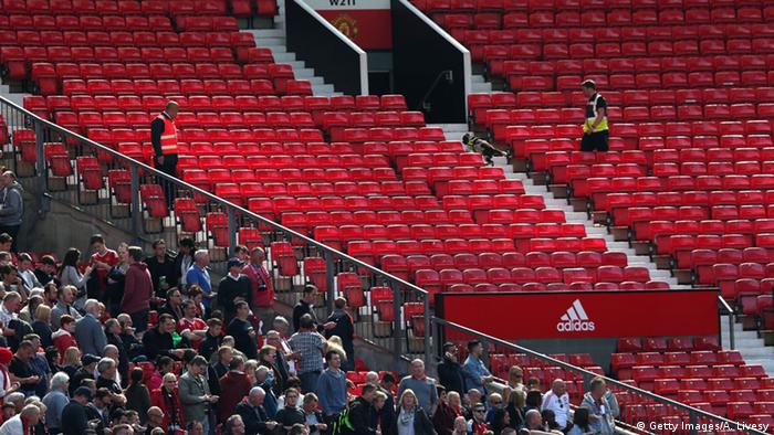 A sniffer dog patrols the stands after fans were evacuated from the ground prior to the Barclays Premier League match between Manchester United and AFC Bournemouth at Old Trafford on May 15, 2016 in Manchester, England. (Photo by Alex Morton/Getty Images)