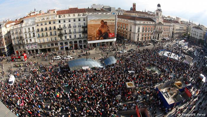 People fill Puerta del Sol square during a march to mark the 5th anniversary of the indignados movement in Madrid, Spain, May 15, 2016. Picture taken with an eye fish lens. REUTERS/Sergio Perez