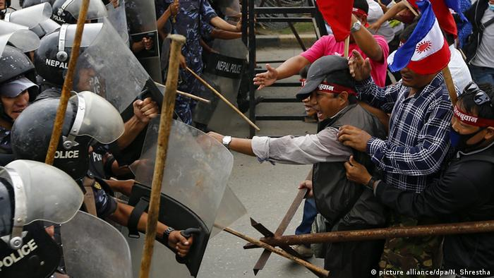 Activists from the ethnic Madhesi community clash with riot police during anti-government protests in Kathmandu in 2016
