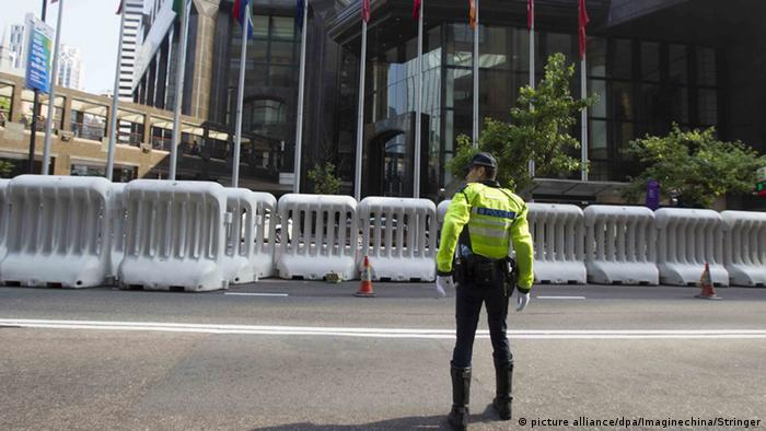 Police cordon off the area surrounding the Hong Kong Exhibition Center, where Zhang is expected to attend the Belt and Road Summit