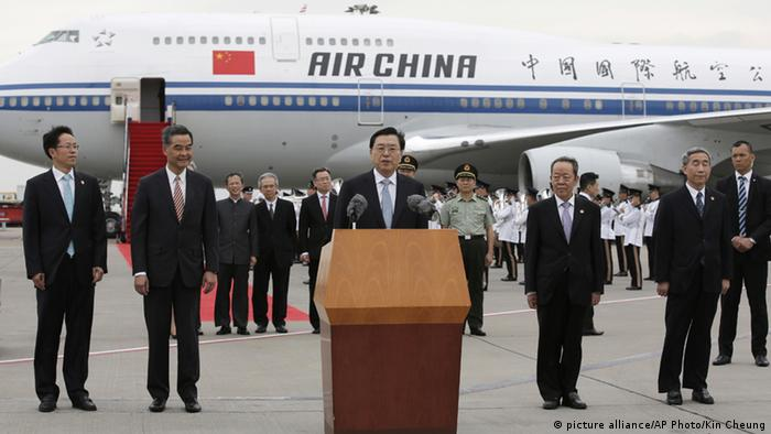Zhang addressing people after disembarking a jet