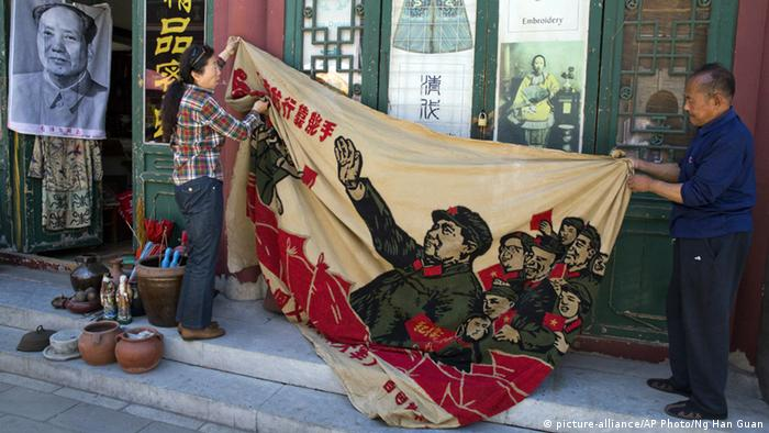 Vendors in Peking displayed relics of the Cultural Revolution on the 50th anniversary