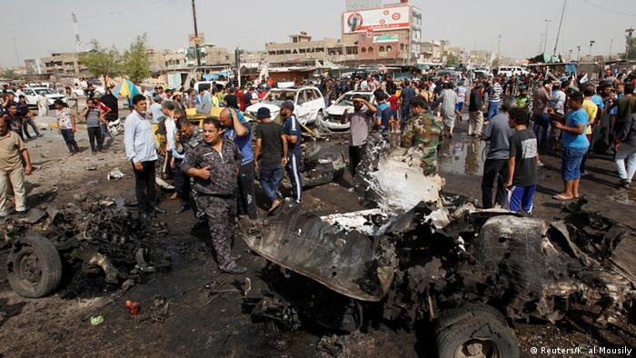 Iraqi security forces and people gather at the site of a car bomb attack in Baghdad's mainly Shi'ite district of Sadr City, Iraq, May 17