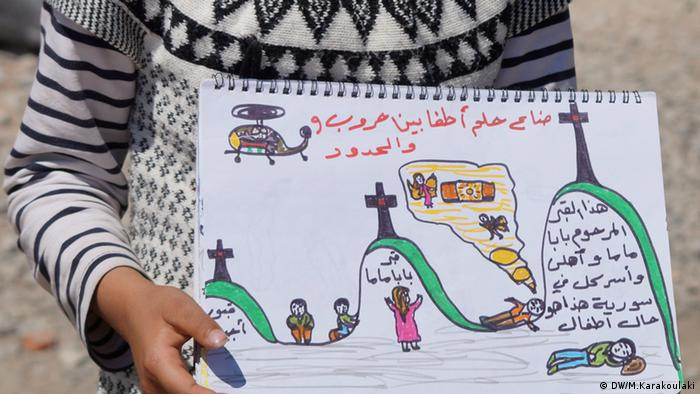 A refugee girl holding a painting (photo: Marianna Karakoulaki)