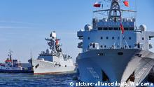 epa04967162 Chinese Navy replenishment ship 'Qiandaohu' (R) and multi-role frigate 'Yiyang' (L) are seen as they enter the port of Gdynia in Gdynia, Poland, 07 October 2015. Three Chinese naval vessels, a destroyer 'Jinan', a multi-role frigate 'Yiyang' and replenishment ship 'Qiandaohu', came to Gdynia for the Chinese Navy's first-ever visit to Poland. The ships are part of a task force which recently completed an anti-piracy mission in the Gulf of Aden. The ships are currently on a five-month tour of seaports worldwide and have already visited Sudan, Egypt, Denmark, Finland and Sweden. The visit to Poland is aimed at developing friendly relations and exchange between China and Poland. +++ (C) picture-alliance/dpa/A. Warzawa