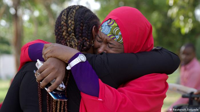 Two women from #Bringbackourgirls campaign hug each other in Nigeria.