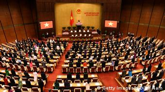 Deputies stand up and sing the national anthem at the opening of the summer session of the National Assembly in Hanoi on The deputies began their 5-week-long summer session (Photo: HOANG DINH NAM/AFP/Getty Images)