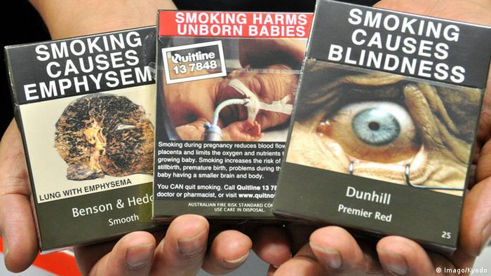 Three cigarette packets with graphic health warnings