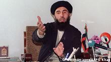 CHAHAR SIAB, AFGHANISTAN: Afghan Prime minister Gulbuddin Hekmatyar addresses a press conference 12 January 1994 in his headquarters in Chahar Saib, south of Kabul. Hekmatyar, leader of Hezb-I-Islami (Islamic Party), is an ethnic Pashtun and Sunni Muslim extremist who had won large chunks of CIA and Pakistani aid during the 1979-1989 war against the Soviet Union. He bombed Kabul in the 1990s because he argued he was being excluded from power by the Tajik commander Ahmad Shah Masood. In 1966 Hekmatyar -- whose ideology was widely seen as a precursor of the Taliban movement -- was forced to flee the city when the militia overran it and he than found exile in Iran. AFP PHOTO DIMITRI KOCHKO (Photo credit should read SAEED KHAN/AFP/Getty Images) Copyright: Getty Images/AFP/S. Khan