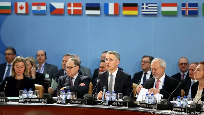 NATO Secretary General Jens Stoltenberg (C) and European Union foreign policy chief Federica Mogherini (L) attend the NATO Foreign ministers meeting