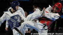 ARCHIV 2013 *** epa03792467 Mongolian Tumenbayar Molom (L) competes with Belgium Mourad Laachraoui during their fight in the category of -54 kilograms for the World Championship of Taekwondo in Puebla, Mexico, 18 July 2013. EPA/Francisco Guasco +++(c) dpa - Bildfunk+++ | © picture-alliance/dpa/F. Guasco