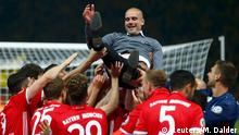 21.5.2016*** Football Soccer - Bayern Munich v Borussia Dortmund - German Cup (DFB Pokal) Final - Olympiastadion, Berlin, Germany - 21/05/16. Bayern Munich's coach Pep Guardiola and players celebrate after winning the German Cup. REUTERS/Michael Dalder TPX IMAGES OF THE DAY DFB RULES PROHIBIT USE IN MMS SERVICES VIA HANDHELD DEVICES UNTIL TWO HOURS AFTER A MATCH AND ANY USAGE ON INTERNET OR ONLINE MEDIA SIMULATING VIDEO FOOTAGE DURING THE MATCH. © Reuters/M. Dalder