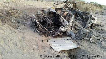 The destroyed vehicle in which Mullah Mohammad Akhtar Mansour was traveling in the Ahmad Wal area in Baluchistan province of Pakistan, near Afghanistan's border (AP Photo/Abdul Salam Khan)