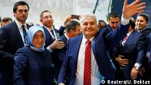 22.05.2016 Turkey's Transportation Minister Binali Yildirim, accompanied by his wife Semiha Yildirim, greets members of his party as he arrives for the Extraordinary Congress of the ruling AK Party (AKP) to choose the new leader of the party, in Ankara, Turkey May 22, 2016. REUTERS/Umit Bektas TPX IMAGES OF THE DAY Reuters/U. Bektas