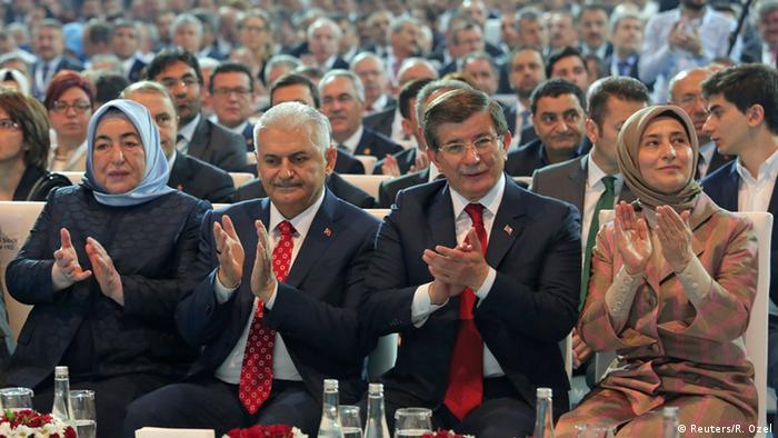 Yildirim with predecessor Davutoglu at the AKP party congress