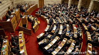 Prime Minister of Greece Alexis Tsipras delivers a speech during a debate in the Parliament plenum