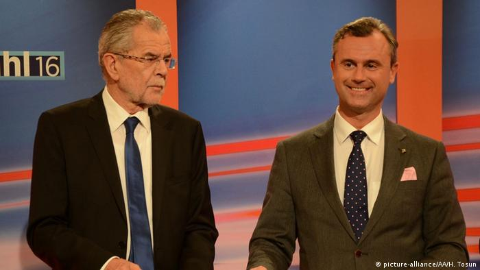 Presidential candidate of the Freedom Party Norbert Hofer (R) and Presidential candidate of Green Party, Alexander Van der Bellen (L) are seen as they attend a TV program in Austria