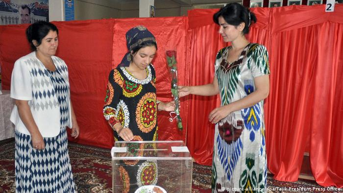 A Tajik woman casting her ballot at a polling station during the Referendum in Dushanbe, Tajikistan