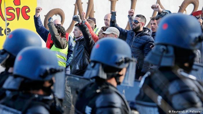 French gendarmes take position after striking workers blockaded roads