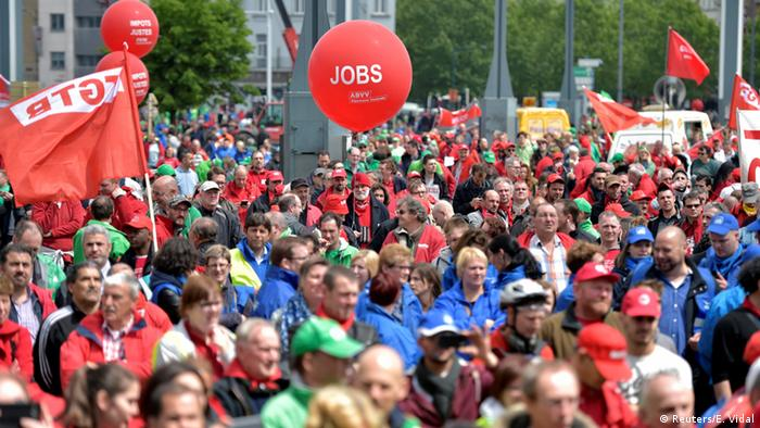 Tens-of-thousands of protesters assemble in Brussels, but a big red balloon, which has 'jobs' printed on it in large letters stands out in the crowd.