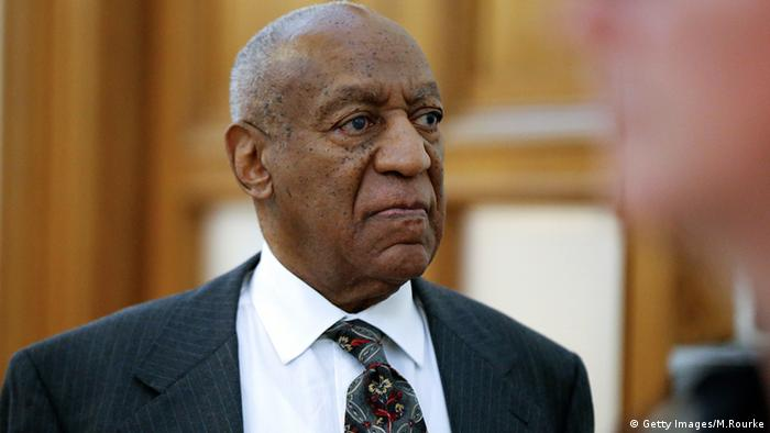 Bill Cosby in a suit and tie leaves the court house in Norristown, PA.